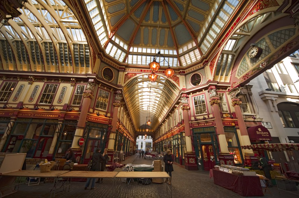 Stock Photo: 4282-29164 England, London, City of London. Stallholders setting out stalls in the morning at Leadenhall Market, a preserved Victorian covered shopping mall at Gracechurch Street in the City of London.