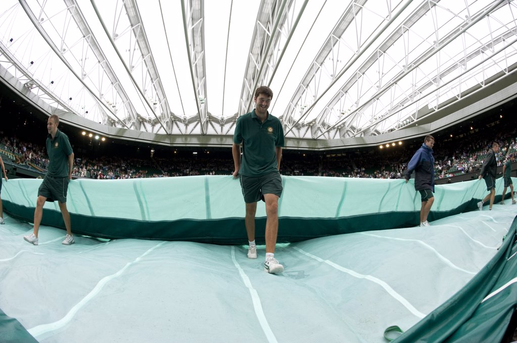 Stock Photo: 4282-29250 England, London, Wimbledon. The covers are removed from Centre Court under the roof during the 2011 Wimbledon Tennis Championships.