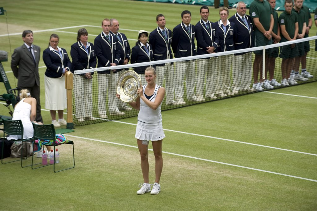 Stock Photo: 4282-29261 England, London, Wimbledon. Petra Kvitova (CZE) with the Venus Rosewater Dish on centre court after victory in the Ladies' singles final at the 2011 Wimbledon Tennis Championships.