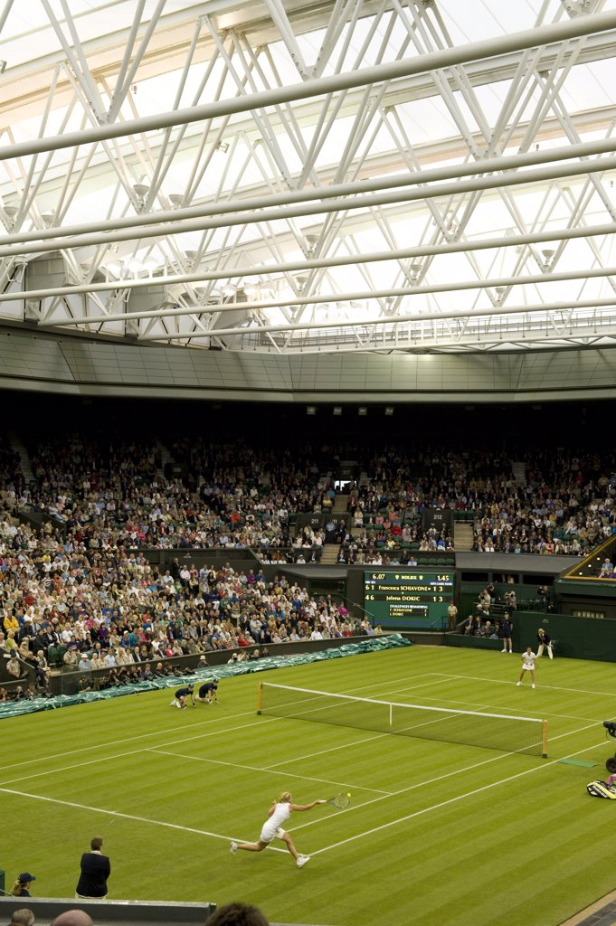 England, London, Wimbledon. A match between Francesca Schiavone and Jelena Dokic under the roof on Centre Court at the 2011 Wimbledon Tennis Championships. : Stock Photo