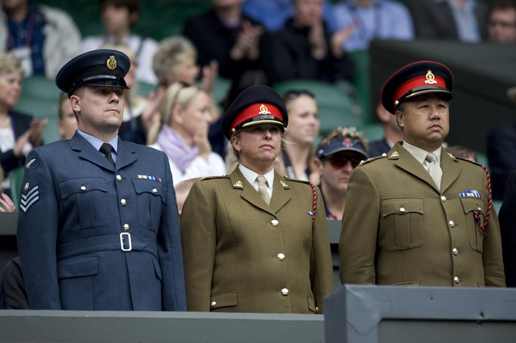 Stock Photo: 4282-29352 England, London, Wimbledon. Chief Service Stewards stand on Centre Court during Armed Services day during the 2011 Wimbledon Tennis Championships.