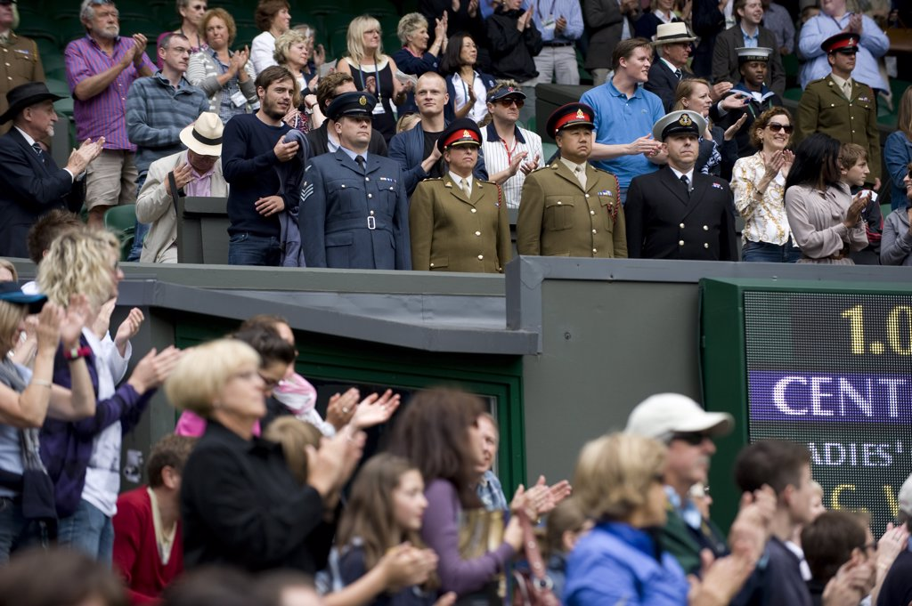 Stock Photo: 4282-29353 England, London, Wimbledon. Chief Service Stewards stand on Centre Court during Armed Services day during the 2011 Wimbledon Tennis Championships.