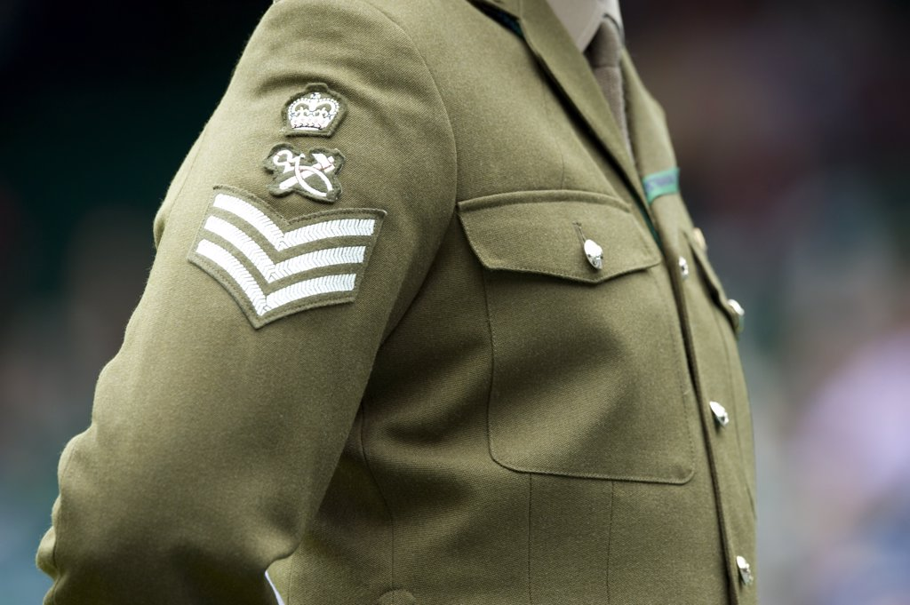 England, London, Wimbledon. A member of the UK armed forces recruited as a steward at the 2011 Wimbledon Tennis Championships. : Stock Photo