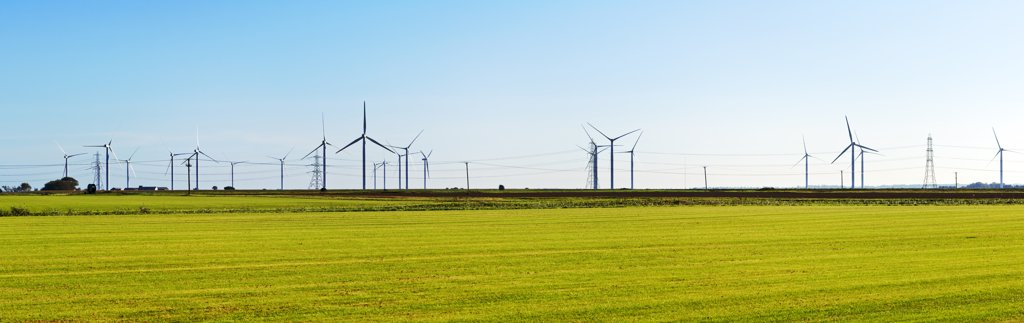 Stock Photo: 4282-29721 England, Kent, Romney. A panoramic view of the wind turbines and electricity cables near Romney Marsh.