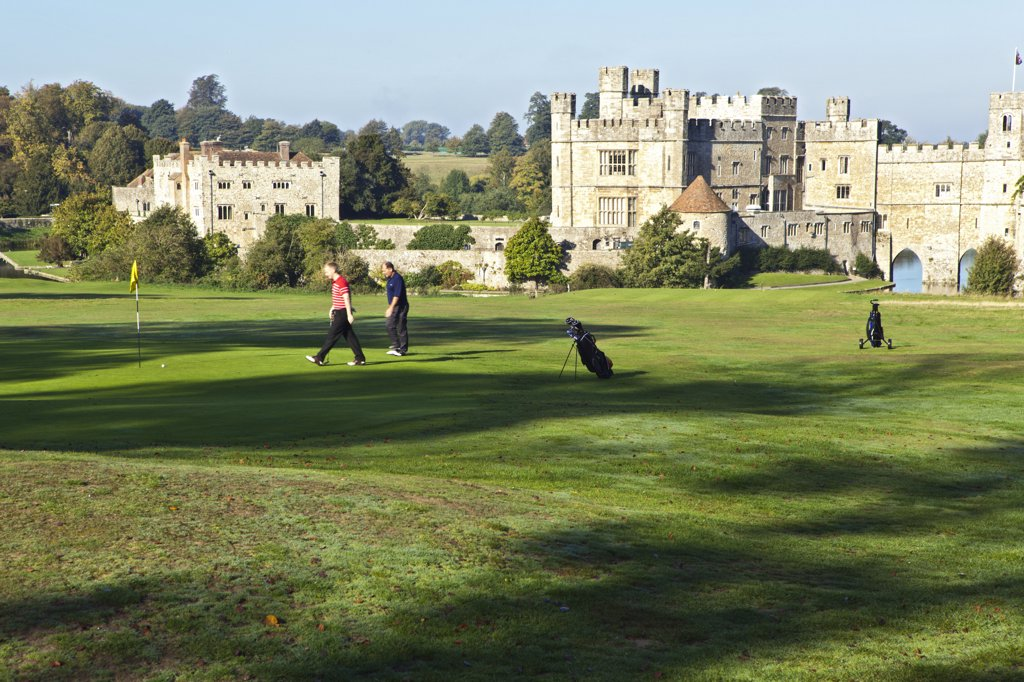 Stock Photo: 4282-29733 England, Kent, Leeds Castle. Golfers playing on the course at Leeds Castle.