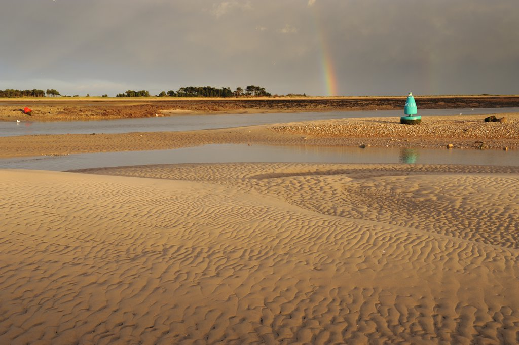 Stock Photo: 4282-29791 England, Norfolk, Wells-next-the-Sea. Rainbow over the 'East Hills' off Wells-next-the-sea, with sandbanks in the foreground.