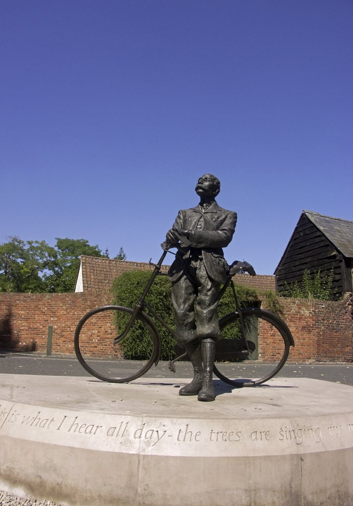 Stock Photo: 4282-29906 England, Herefordshire, Hereford. Bronze statue of Edward Elgar with his Sunbeam bicycle in Cathedral Close.