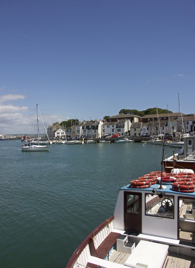 Stock Photo: 4282-29923 England, Dorset, Weymouth. Boats moored in the outer harbour at Weymouth, venue for all sailing events for the London 2012 Olympic and Paralympic Games.