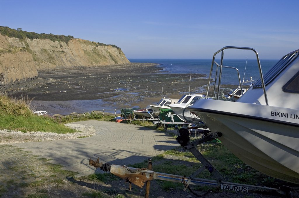 Stock Photo: 4282-29978 England, North Yorkshire, Robin Hoods Bay. Boats mounted on trailers by the slipway at Robin Hoods Bay.