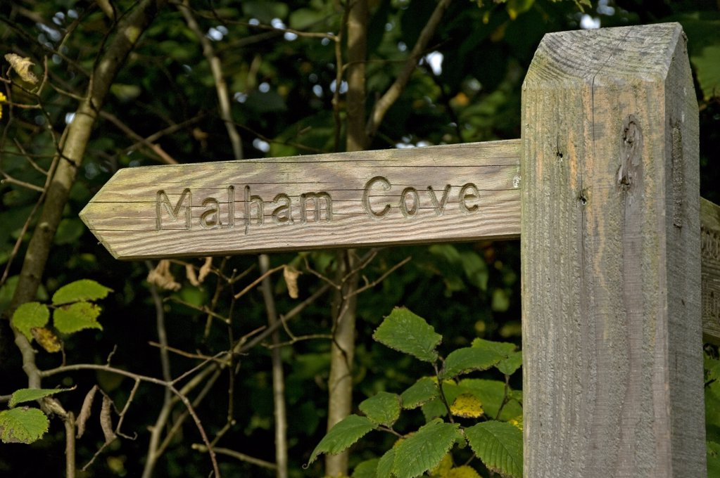 Stock Photo: 4282-30007 England, North Yorkshire, Malhamdale. Wooden signpost pointing to Malham Cove.