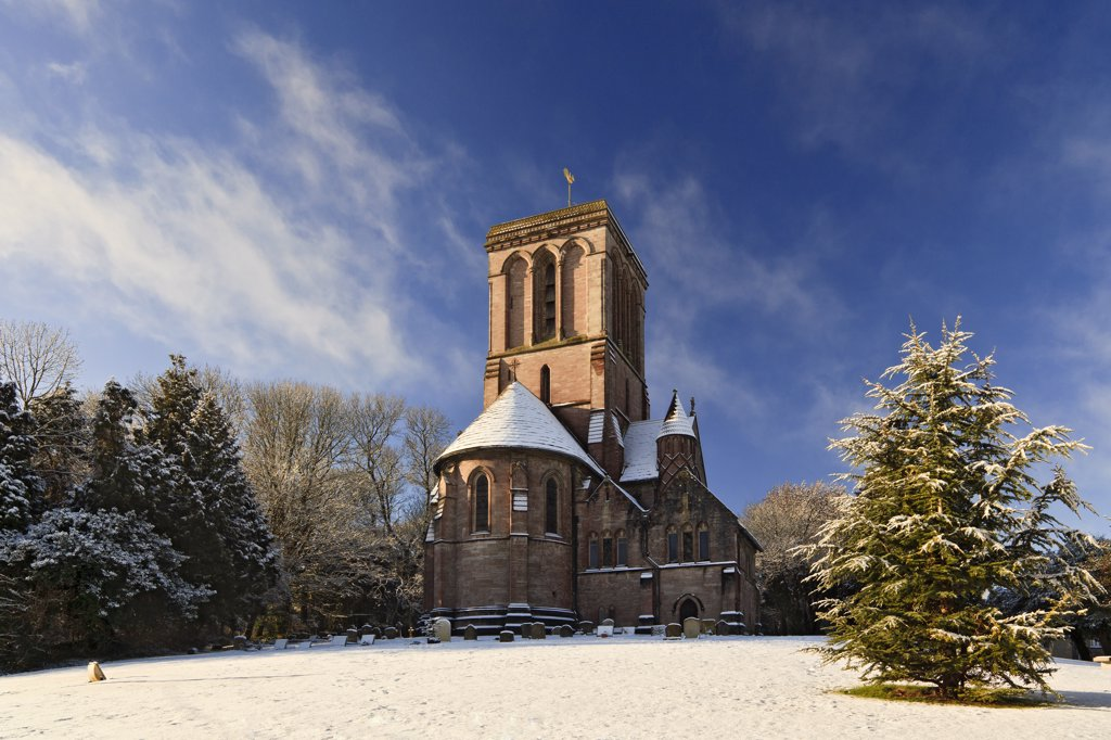 Stock Photo: 4282-30117 England, Dorset, Kingston. Snow covering the grounds of the Church of St. James at Kingston, on the Isle of Purbeck.