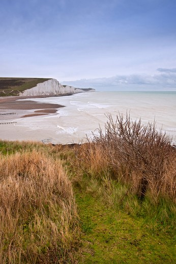 Stock Photo: 4282-30147 England, East Sussex, Seaford. View from Seaford Head hills across the Cuckmere estuary to the chalk cliffs of the Seven Sisters on an Autumn morning.
