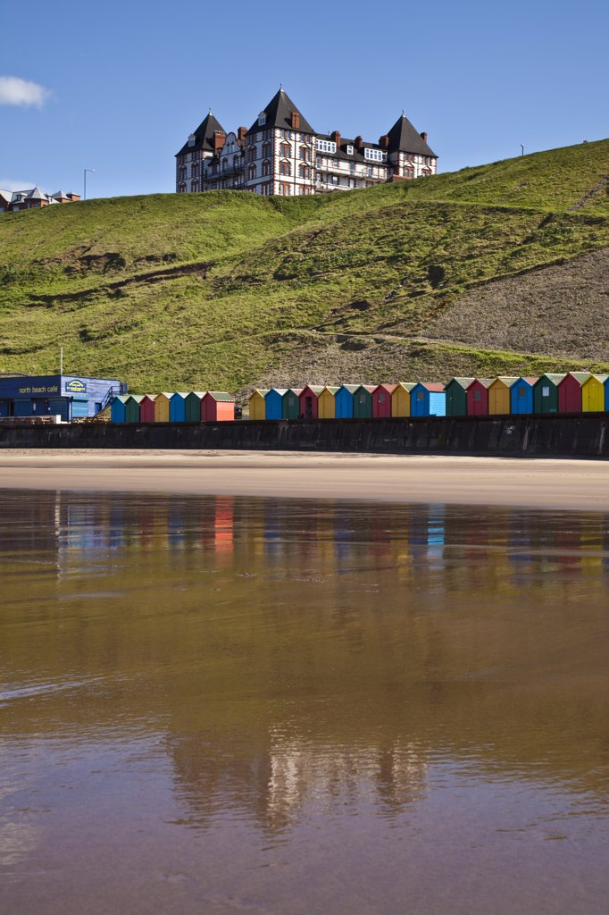 England, North Yorkshire, Whitby. Colourful beach huts along West Cliff Beach in Whitby. : Stock Photo