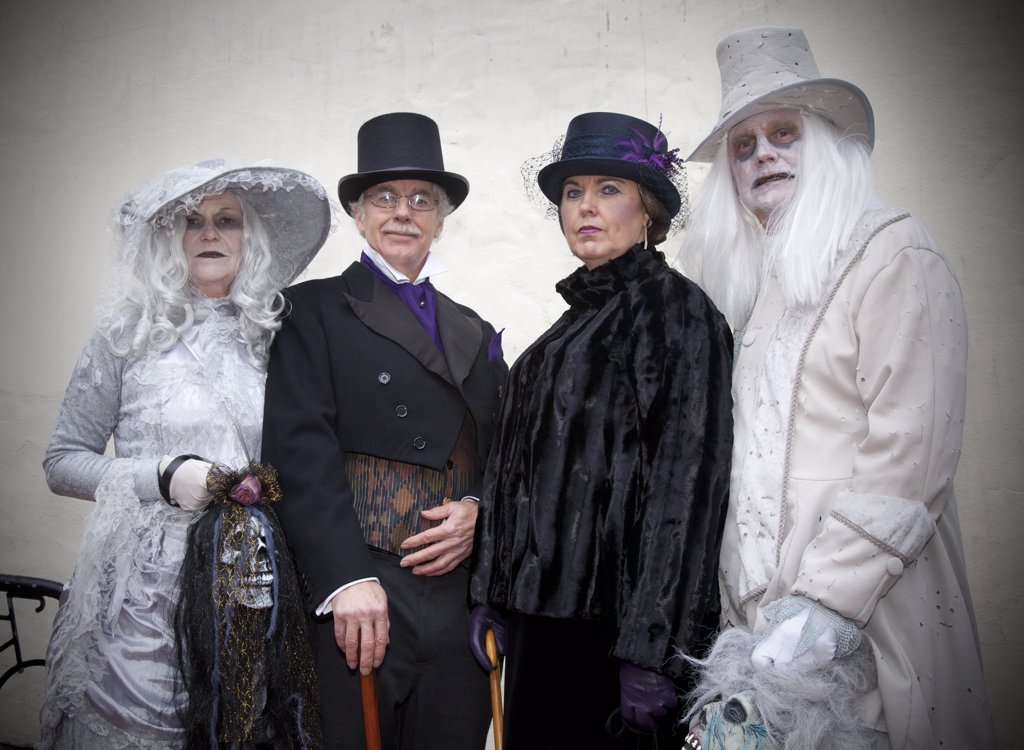 Stock Photo: 4282-30220 England, North Yorkshire, Whitby. People dressed up in sinister clothing for the Whitby Goth Weekend, a twice yearly festival held in Whitby because of its association with the novel 'Dracula'.