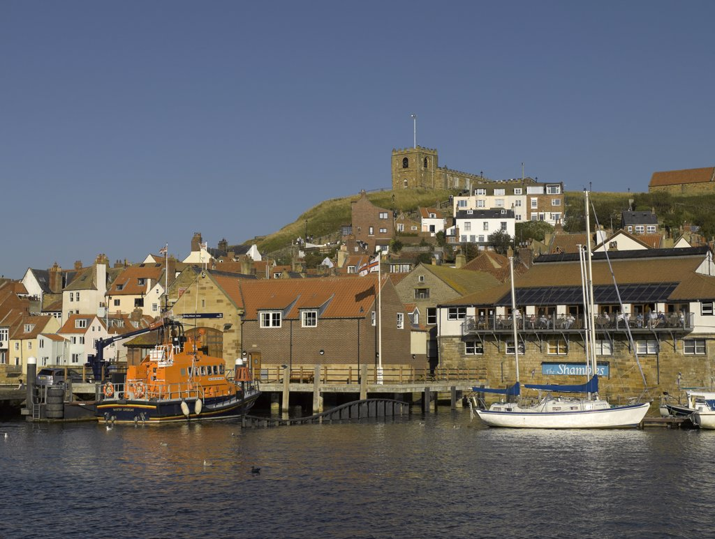 Stock Photo: 4282-30306 England, North Yorkshire, Whitby. RNLI lifeboat George and Mary Webb moored below St Marys Church at Whitby Lifeboat Station.