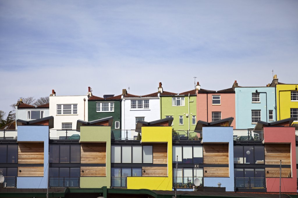 Stock Photo: 4282-30325 England, Bristol, Bristol. Colourful waterside flats in Pooles Wharf.