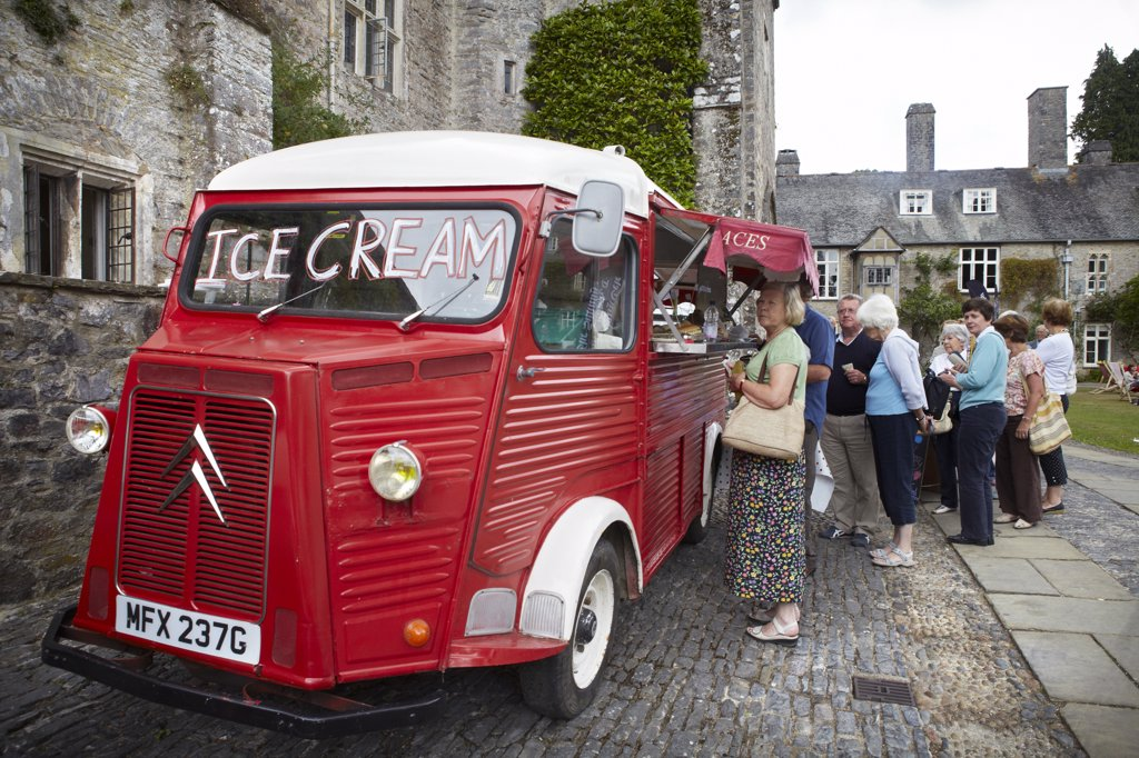 Stock Photo: 4282-30394 England, Devon, Dartington. People queuing for an ice cream from a vintage van at The Telegraph Ways With Words Literary Festival held at Dartington Hall.