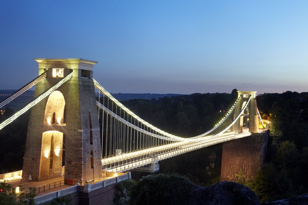 Stock Photo: 4282-30434 England, Bristol, Clifton. The Clifton Suspension Bridge spanning the Avon Gorge at night. The bridge was designed by Isambard Kingdom Brunel and completed in 1864, 5 years after his death.