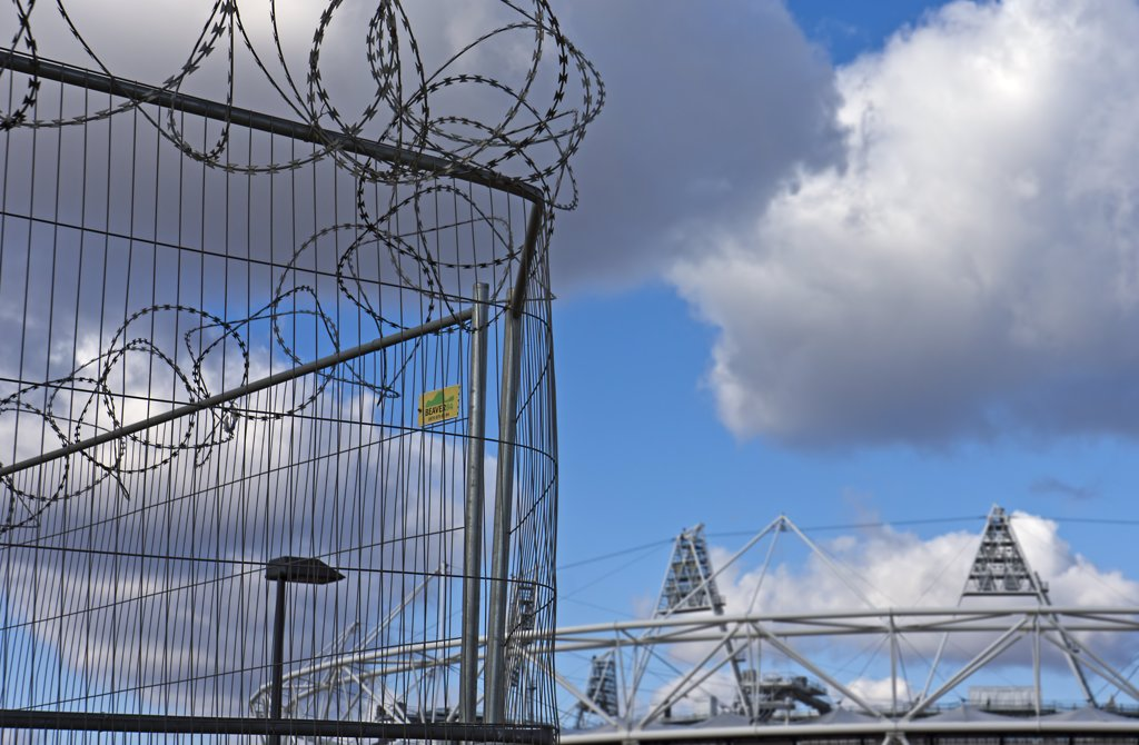 England, London, Stratford. Razor wire security fencing in front of the London Olympic Stadium. : Stock Photo