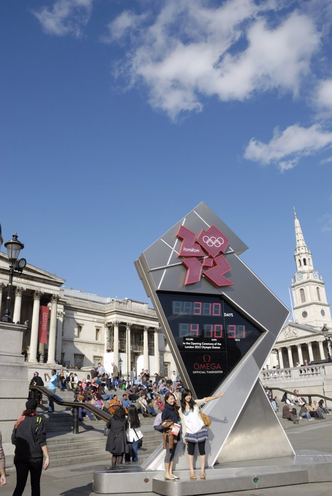 Stock Photo: 4282-30610 England, London, Trafalgar Square. Tourists standing by the Olympic Games London 2012 countdown clock in Trafalgar Square.