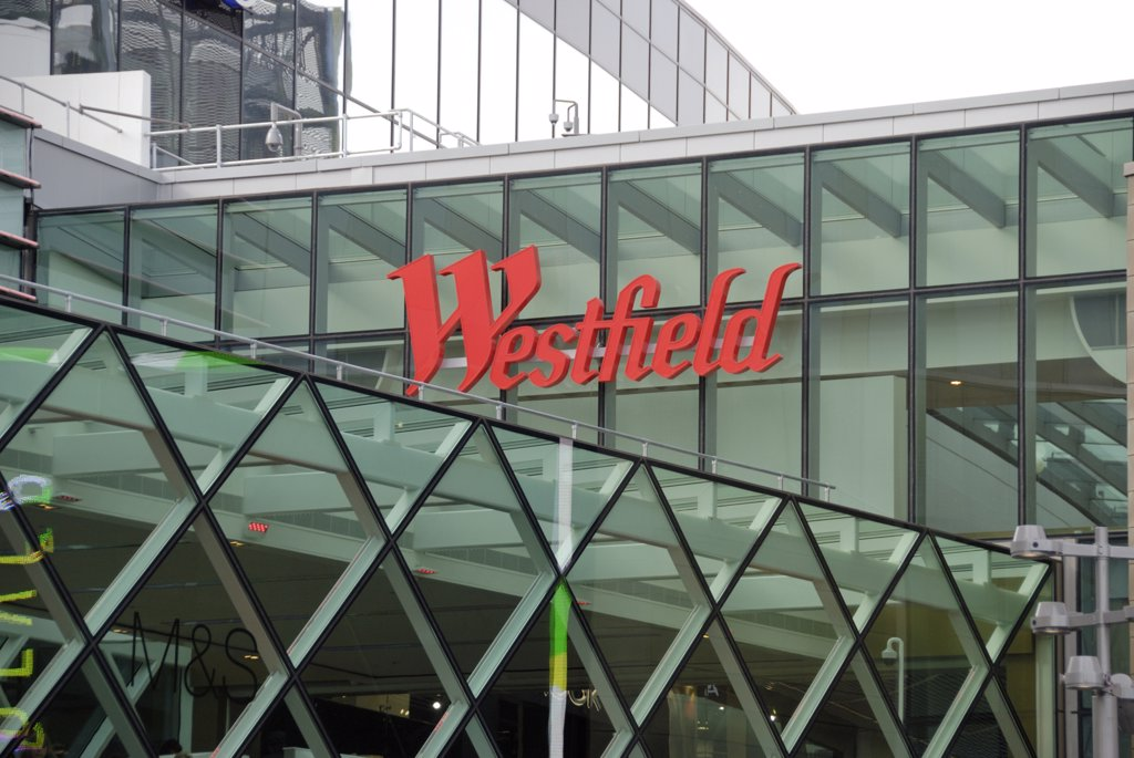England, London, Stratford. Westfield Stratford City shopping centre sign on the outside of the building. The centre opened in 2011 and is the 3rd largest shopping centre in the UK. : Stock Photo