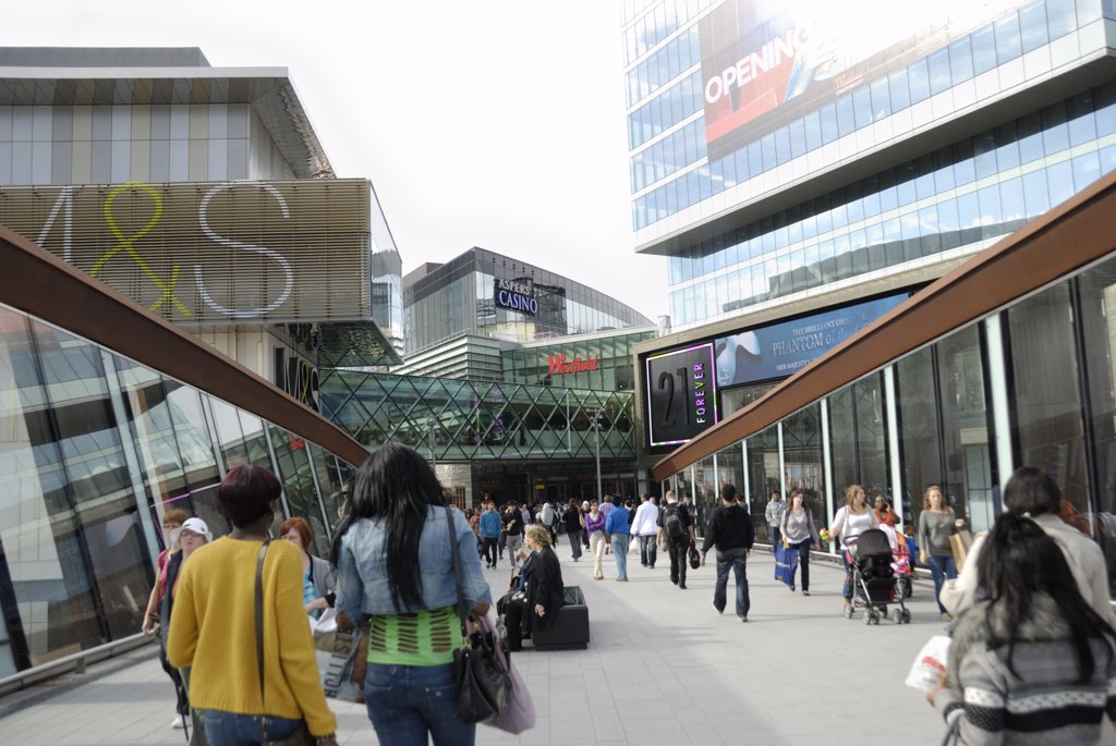 Stock Photo: 4282-30629 England, London, Stratford. Footbridge leading into Westfield Stratford City shopping centre. The centre opened in 2011 and is the 3rd largest shopping centre in the UK.