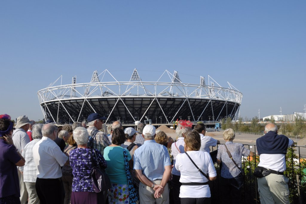 England, London, Stratford. Tourists viewing the Olympic Stadium in Olympic Park. : Stock Photo