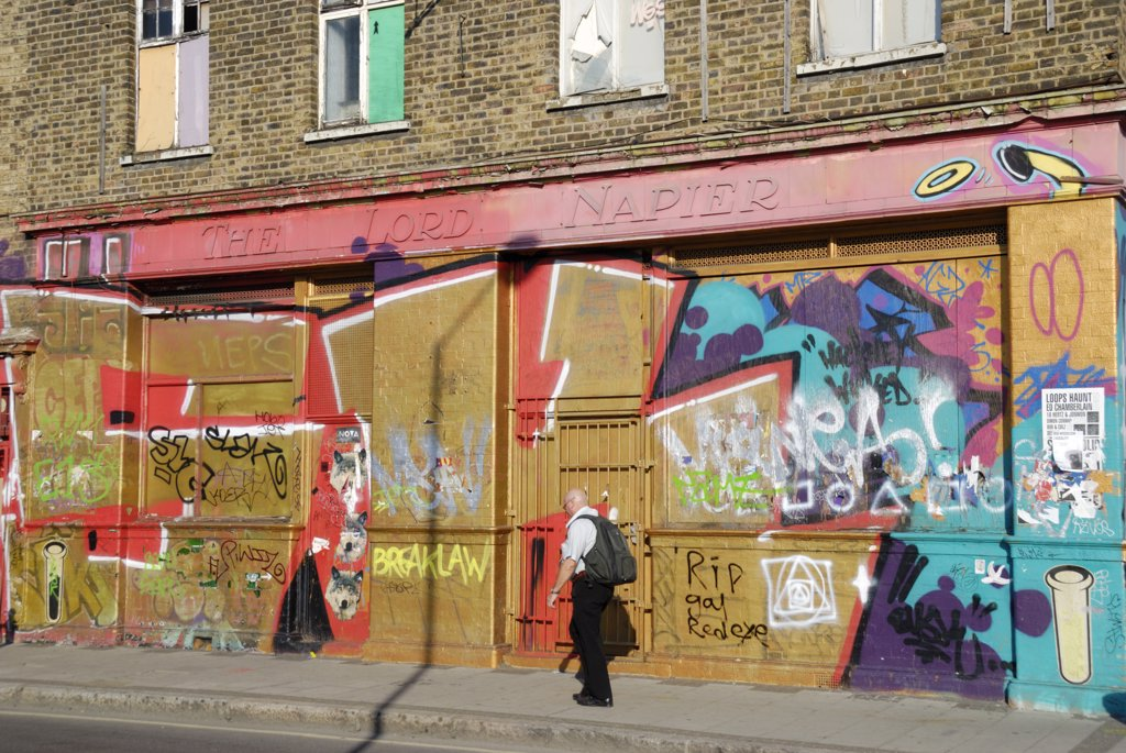 England, London, Hackney Wick. Graffiti covering the walls and boards of The Lord Napier, a derelict pub in Hackney Wick. : Stock Photo