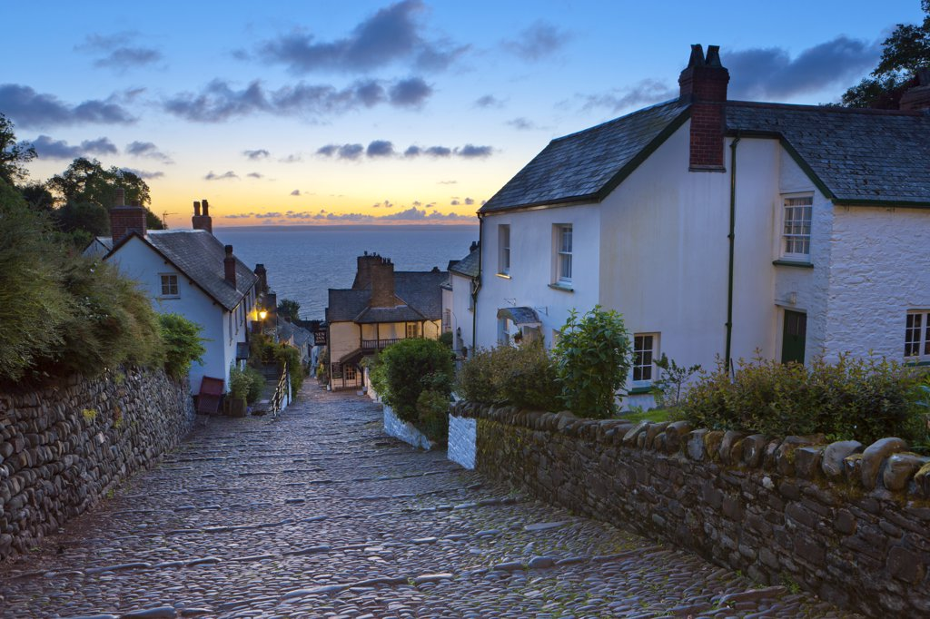 Stock Photo: 4282-30713 England, Devon, Clovelly. Steep narrow cobbled street leading down to the world famous fishing village of Clovelly.