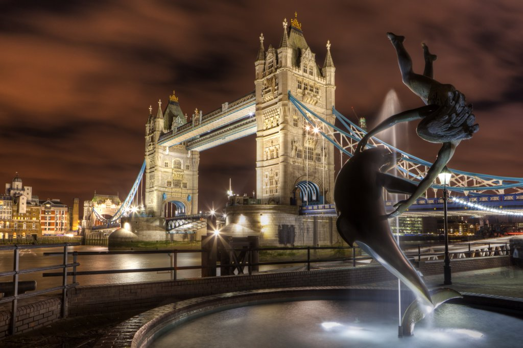 Stock Photo: 4282-30750 England, London, Tower Bridge. David Wynne's 'Girl with a Dolphin' statue on the North bank of the River Thames by Tower Bridge.