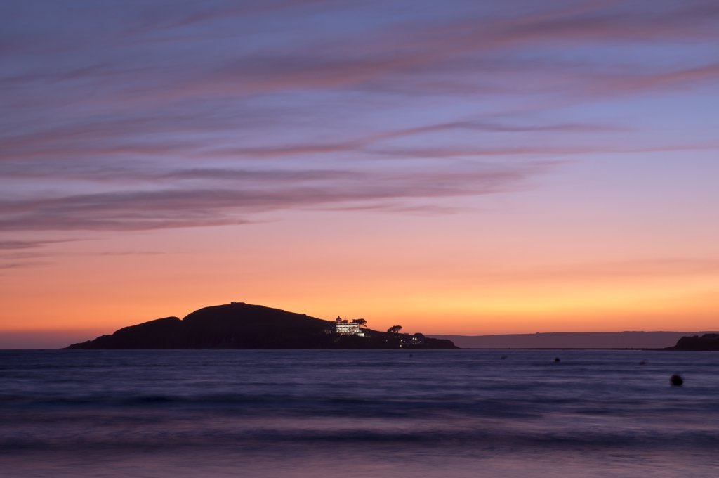 Stock Photo: 4282-30785 England, Devon, Bantham Beach. View from Bantham Beach towards Burgh Island silhouetted at sunset.