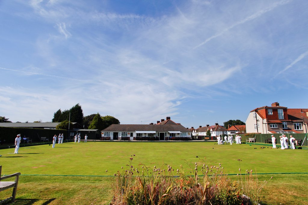 Stock Photo: 4282-30787 England, Kent, West Wickham. A game of bowls at West Wickham bowls club which was founded in 1908.