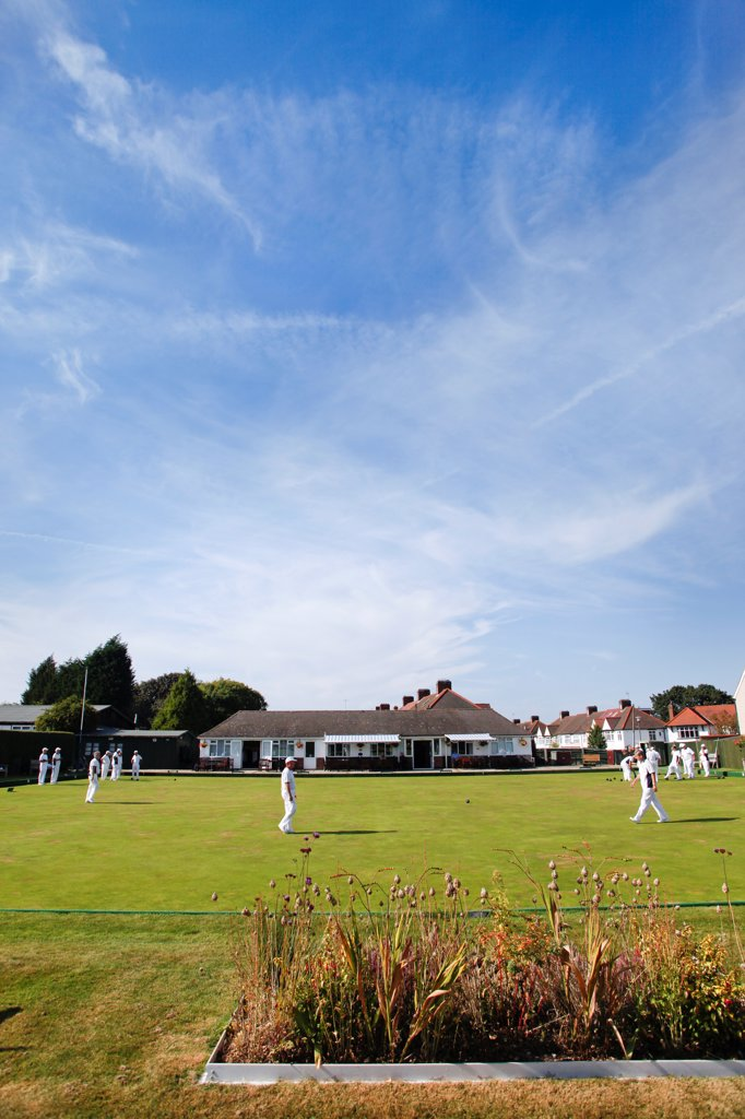 Stock Photo: 4282-30788 England, Kent, West Wickham. A game of bowls at West Wickham bowls club which was founded in 1908.