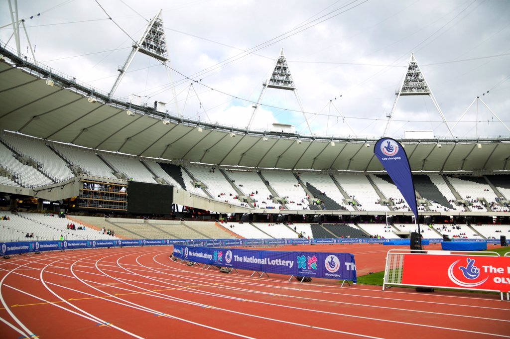 England, London, Stratford . An interior view of the Olympic stadium looking down onto the running track. : Stock Photo