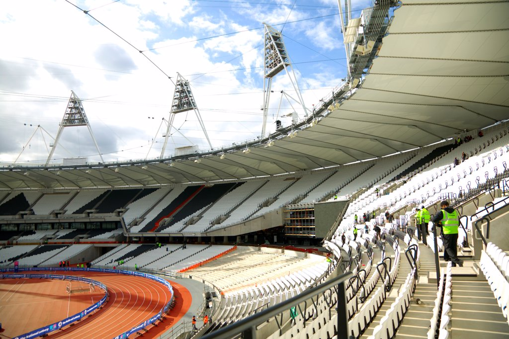 Stock Photo: 4282-30828 England, London, Stratford . An interior view of the Olympic stadium looking down onto the running track.