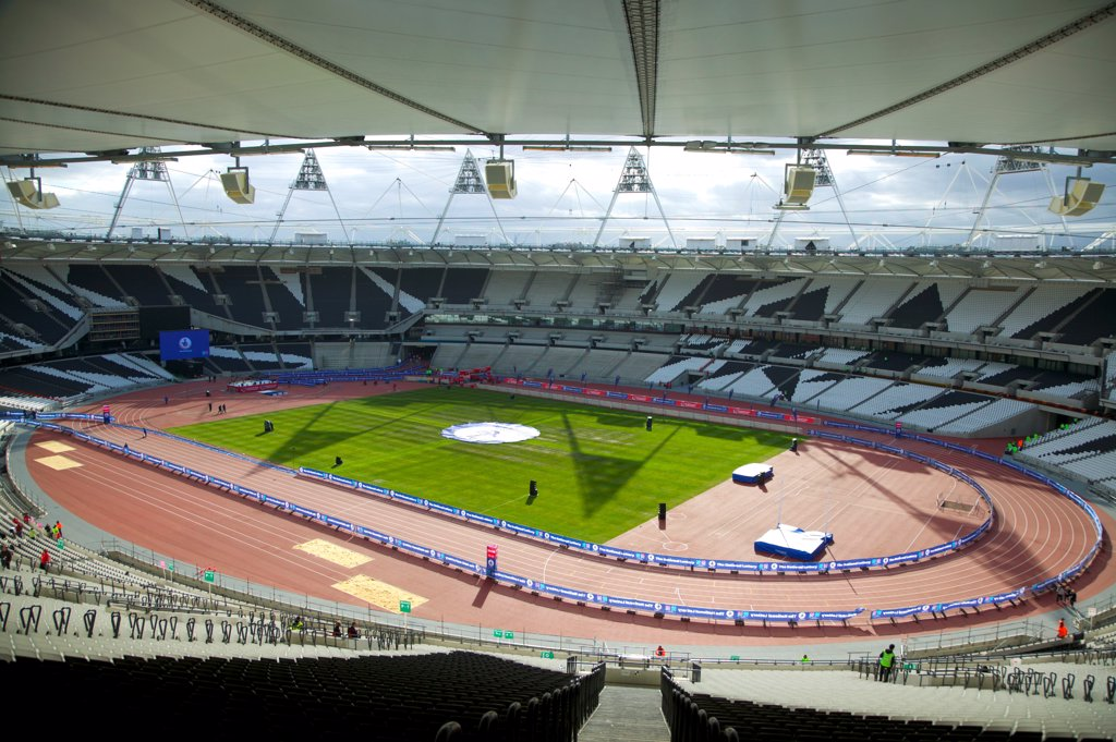 Stock Photo: 4282-30829 England, London, Stratford . An interior view of the Olympic stadium looking down onto the running track.