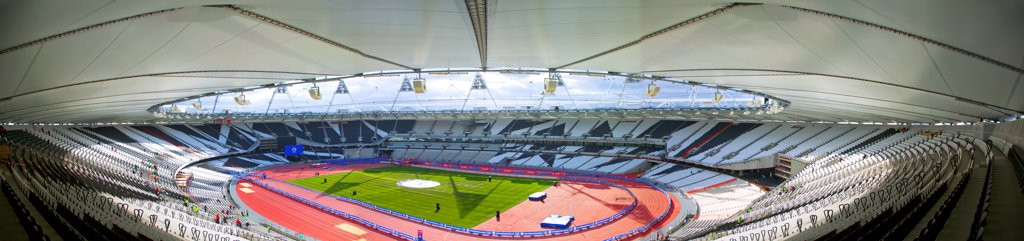 England, London, Stratford . An interior view of the Olympic stadium from the highest seats looking down onto the running track. : Stock Photo
