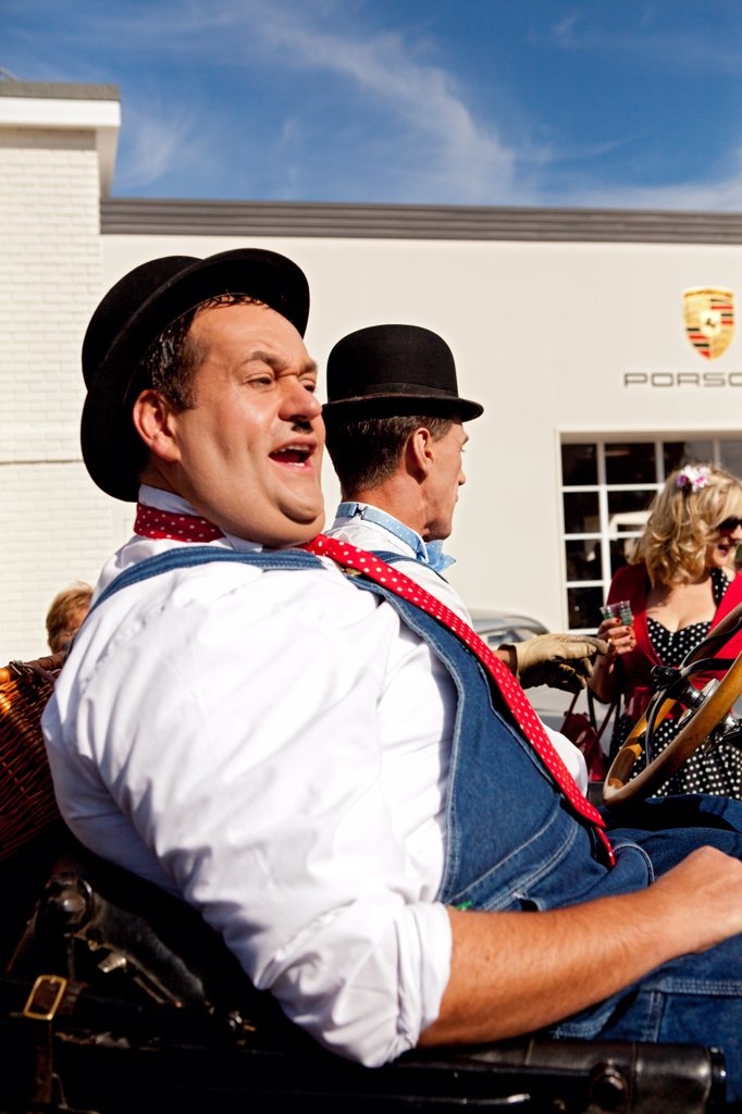 Stock Photo: 4282-30984 England, West Sussex, Goodwood. Laurel and Hardy lookalikes perform for a crowd at Goodwood revival.