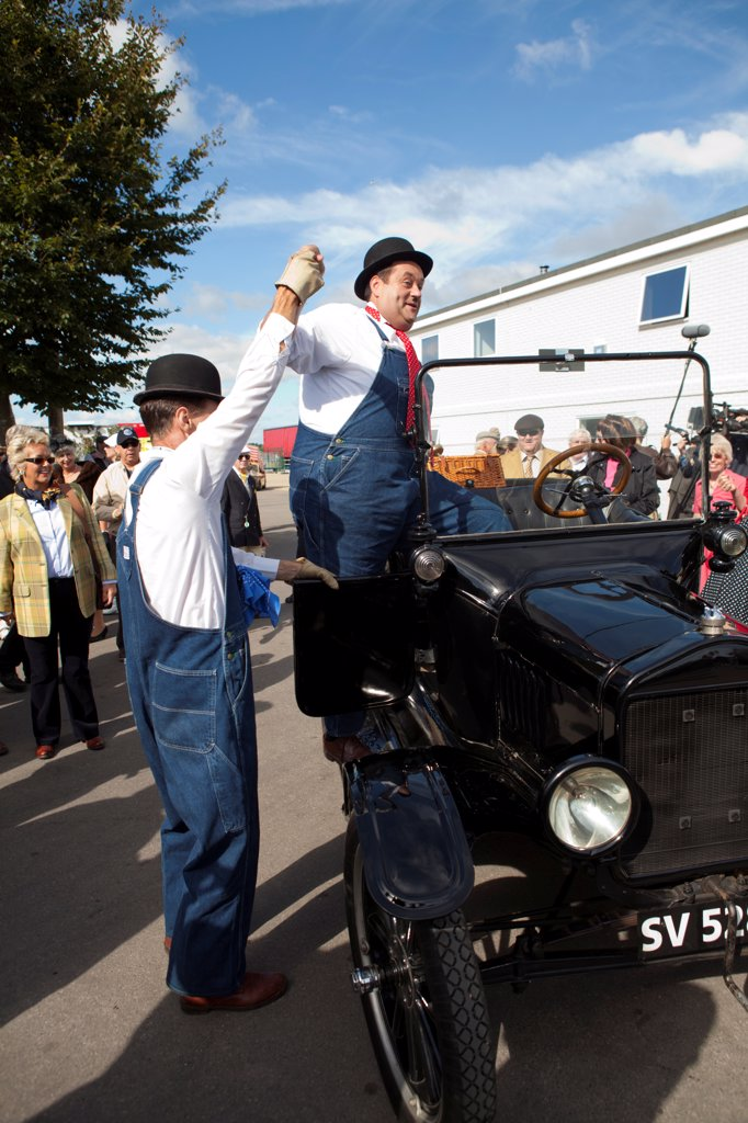 Stock Photo: 4282-30985 England, West Sussex, Goodwood. Laurel and Hardy lookalikes perform for a crowd at Goodwood revival.
