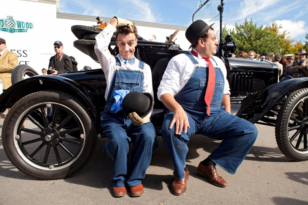 Stock Photo: 4282-30986 England, West Sussex, Goodwood. Laurel and Hardy lookalikes perform for a crowd at Goodwood revival.