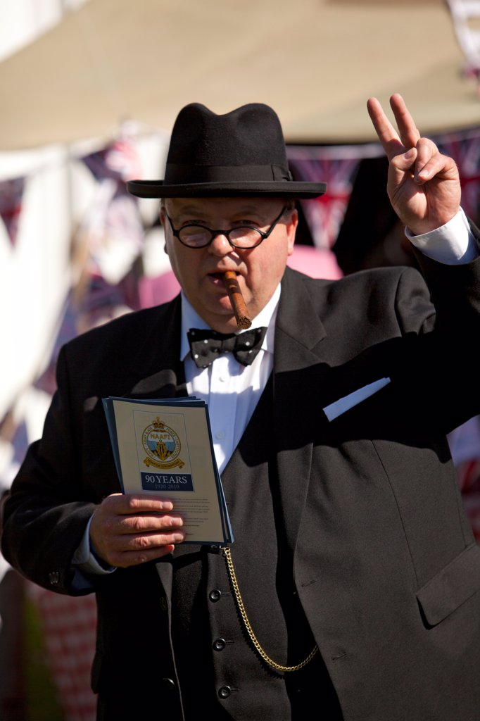 England, West Sussex, Goodwood. A man dressed as Winston Churchill at Goodwood Revival. : Stock Photo
