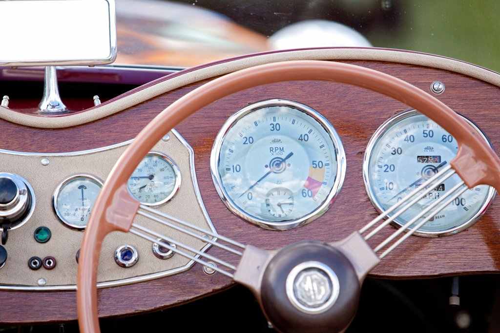 Stock Photo: 4282-30999 England, West Sussex, Goodwood. A close up view of the steering wheel and dashboard of a classic car at Goodwood revival.