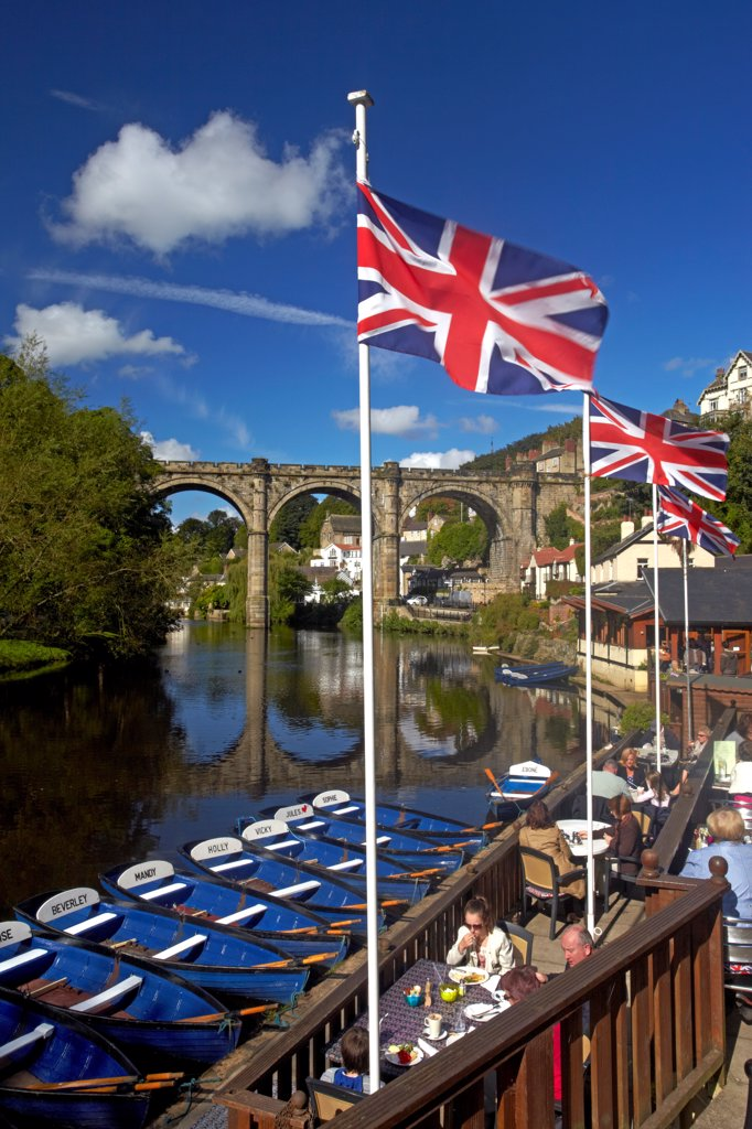 Stock Photo: 4282-31330 England, North Yorkshire, Knaresborough. A view of the River Nidd from the riverside cafe with the Victorian railway viaduct reflected in the waters below.