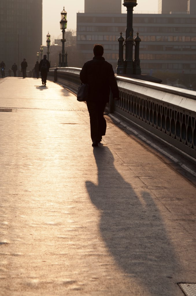 Stock Photo: 4282-31527 England, London, Westminster Bridge. A commuter on Westminster Bridge at sunrise.