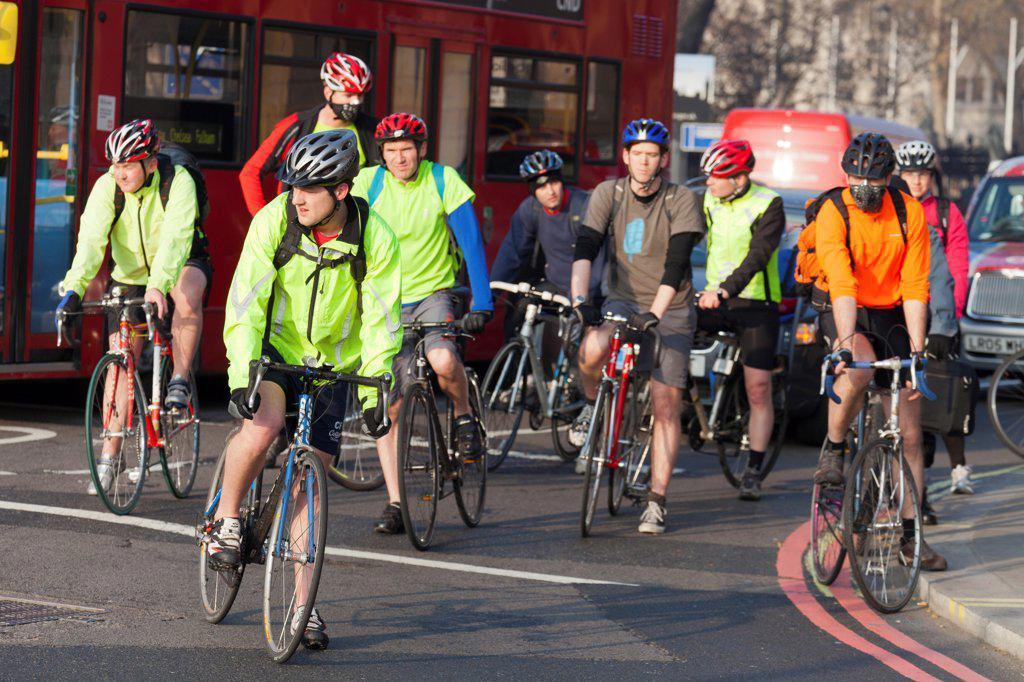 England, London, Victoria Embankment. Massed cyclists turning into Victoria Embankment in London. : Stock Photo