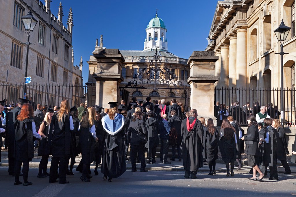 Stock Photo: 4282-31780 England, Oxfordshire, The Sheldonian. Students queueing for the matriculation ceremony at The Sheldonian which is part of Oxford University.