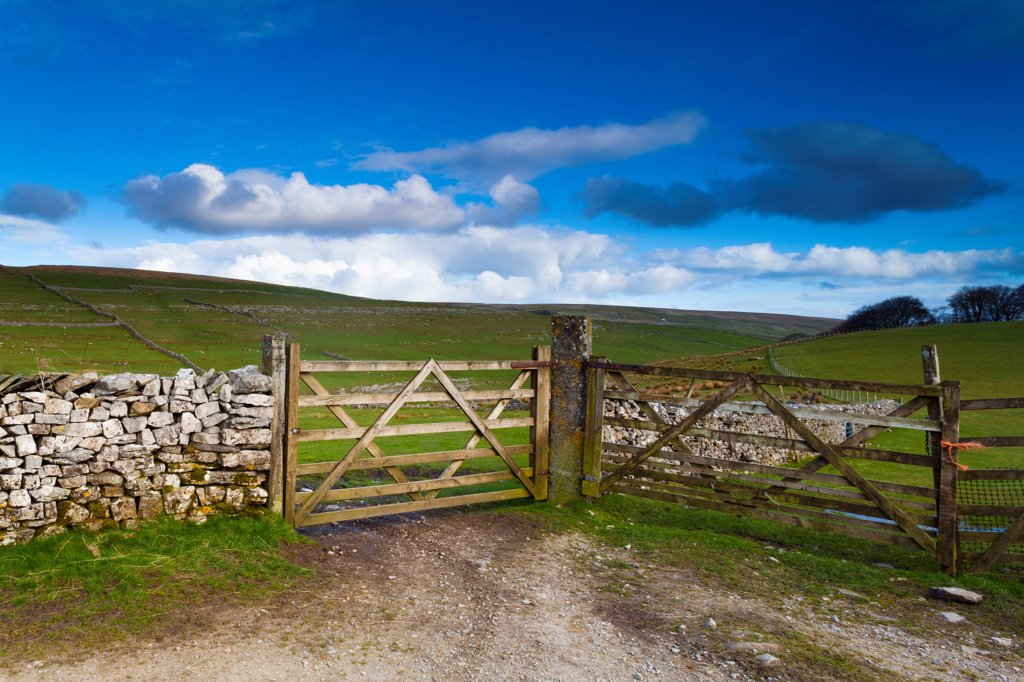 Stock Photo: 4282-31923 England, North Yorkshire, Yorkshire Dales National Park. Farm field and wooden gates near the small village of Horton in Ribblesdale.