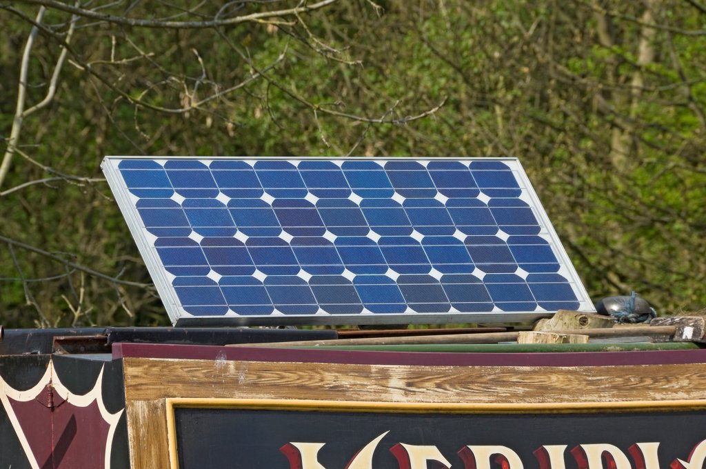 Stock Photo: 4282-32167 England, North Yorkshire, Skipton. A solar panel on board a narrow boat.