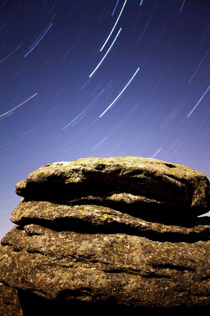 England, Devon, Dartmoor. Polaris star trail over moonlit Combestone Tor on Dartmoor. : Stock Photo