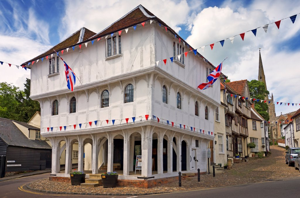 Stock Photo: 4282-32473 England, Essex, Thaxted. The 15th Century Guildhall in Thaxted decorated with bunting.